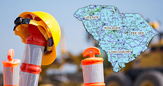 yellow helmet hanging on an orange road cone with a map of the state in the upper right corner