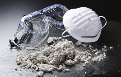 Goggles and a pile of material like lint or loose insulation