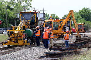 Men and equipment working on railroad