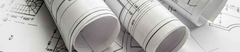photo of engineering drawings rolled on a table